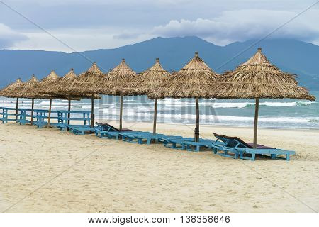 Palm Shelters And Sun Beds In The China Beach