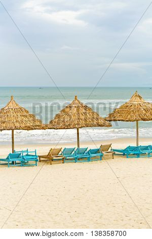 Palm Shelters And Sunbeds In China Beach In Da Nang