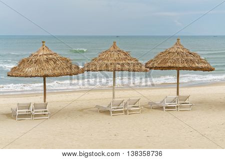 Palm Shelters And Sunbeds On China Beach In Da Nang