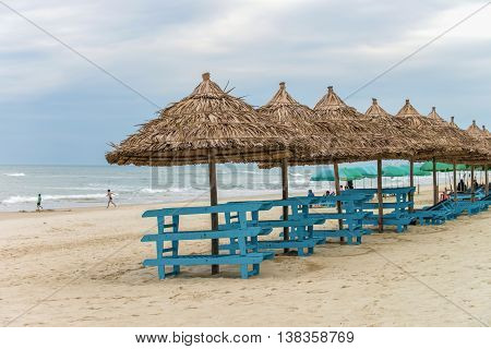 Palm Shelters And Tourists In China Beach In Da Nang