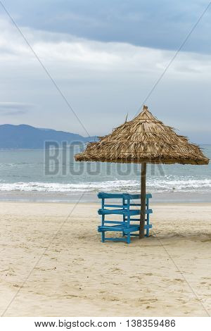 Sunbeds And Palm Shelter In China Beach In Da Nang