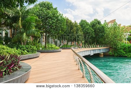Tourists On Sentosa Boardwalk Leading To Sentosa Island Of Singapore