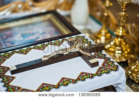 Catholic Wooden Cross With A Crucifix On Table At Church