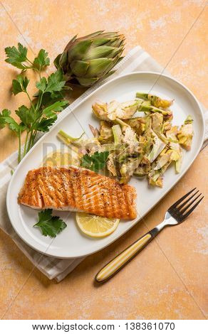 grilled salmon with raw artichoke salad