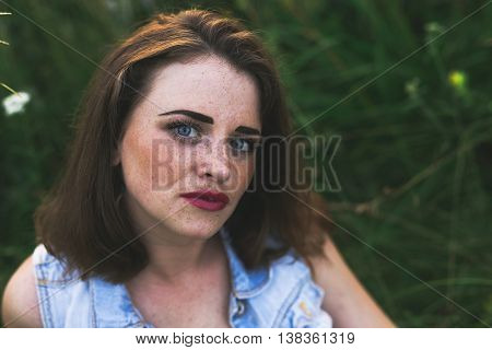 Portrait Of Redhead Girl With Blue Eyes