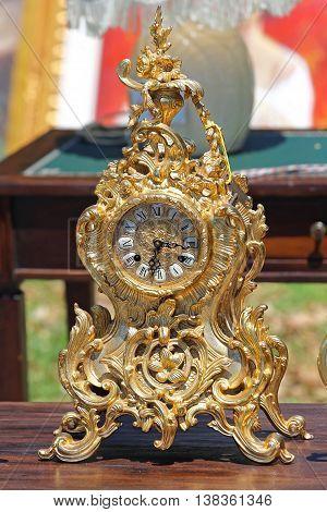Decorative Ancient Analog Gold Clock at Flea Market