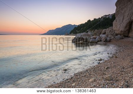 sunset over the beach. Croatia, Dalmatia, Makarska Riviera