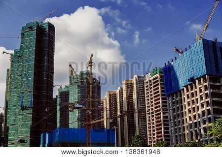 Construction of skyscrapers on a background of clear sky.