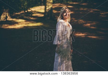 Single Bride In Dappled Sunlight Of Forest