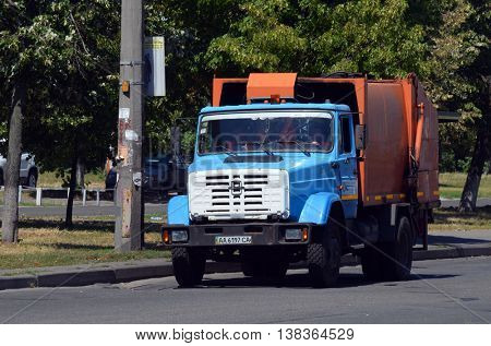 Garbage truck on the street of Kiev. July 13, 2016 Kiev, Ukraine