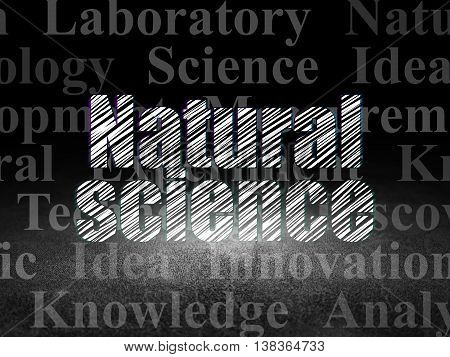Science concept: Glowing text Natural Science in grunge dark room with Dirty Floor, black background with  Tag Cloud