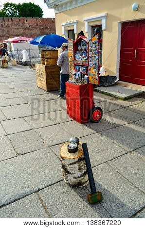 VELIKY NOVGOROD RUSSIA -JUNE 11 2016. Mint attraction - equipment for minting souvenir coins for good luck and souvenirs trade in Veliky Novgorod Russia