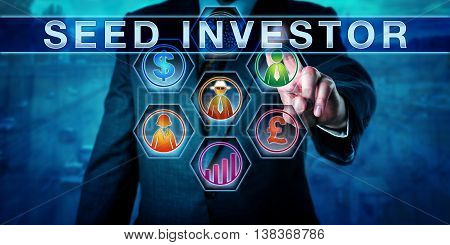 Male entrepreneur is touching SEED INVESTOR on a control monitor. Dollar sign pound sterling growth chart and people icons are lighting up in color. Business concept and venture capital metaphor.