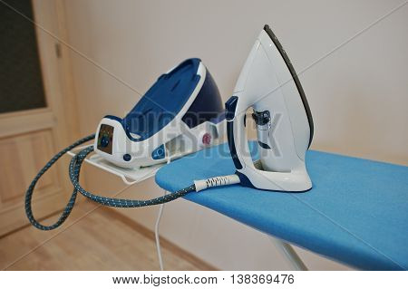 Ironing board with steam iron system deck
