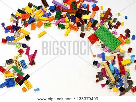 Colorado, USA - June 8, 2016: Studio shot of LEGO bricks in a pile with empty space available for text or image overlay.