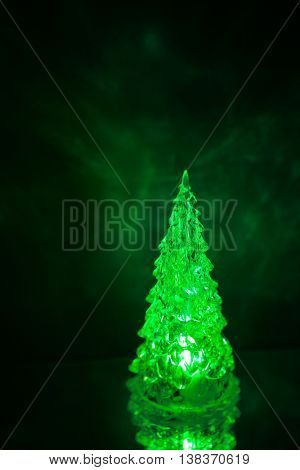 Christmas tree lamp green light with reflection