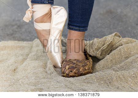 Feet girl in Ballet shoes and Bast shoe on canvas on the road