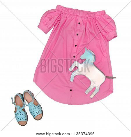 Fashion still life Women's clothing: pink dress shirt blue sandals clutch Top view