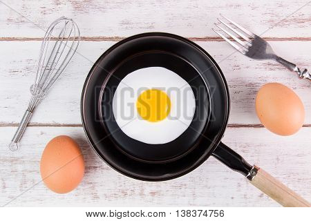 Fried Egg In Small Pan With Handle On White Wooden Board, Top View