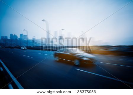 motion blurred traffic with city skyline background
