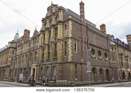 Cambridge England - July 7 2016: Architecture of ancient British buildings at the intersection of Tennis Court Road in Cambridge England.