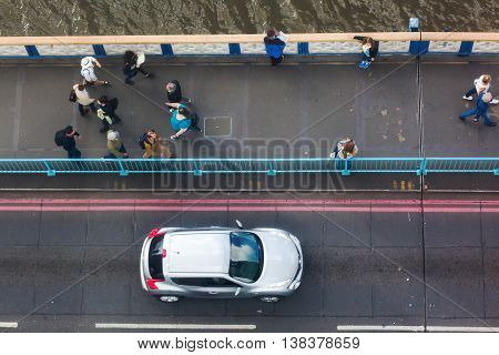 View From High-level Walkway Of Tower Bridge In London, Uk, On The Bridge Traffic