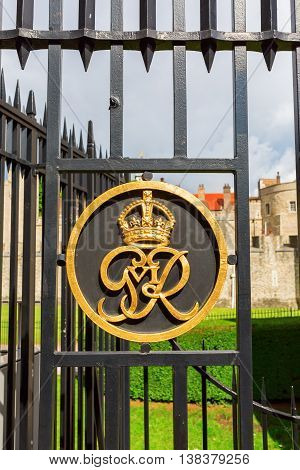 London UK - June 15 2016: golden emblem at the fence of the Tower of London. Today the Tower of London is one of the country's most popular tourist attractions and is protected as a World Heritage Site.