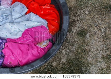 Soak dirty clothes in the basin black for cleanness,Thailand washing clothes style ancient