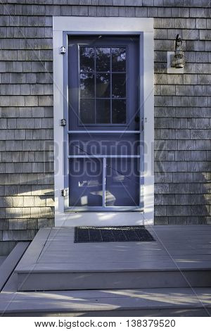 Front door of a house in Wellfleet, MA on Cape Cod.