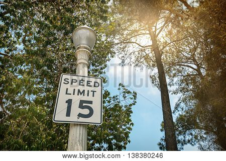 Speed Limit sign:15 miles per hour, outdoor