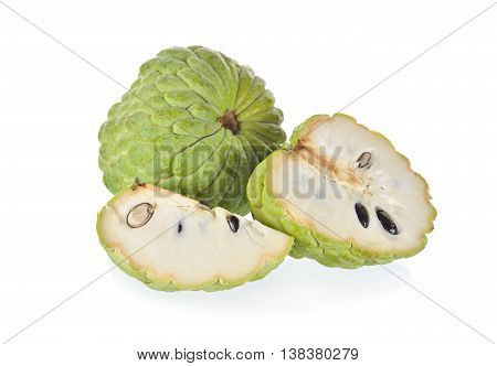 whole and half cut custard apple on white background