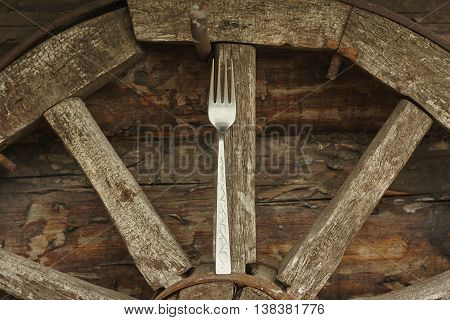 silver fork on vintage lumber wheel close up