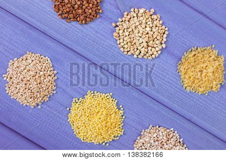 Heap Of Various Groats On Wooden Boards, Healthy Food And Nutrition