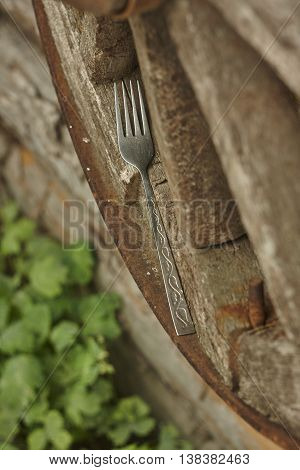 silver fork on vintage lumber wheel edge diagonal close up