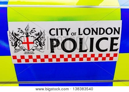 London UK - June 18 2016: sign of the City of London Police at a police car. It is the smallest territorial police force in England and Wales in terms of geographic area and head-count