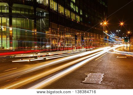 London UK - June 19 2016: night traffic on the Bishopsgate road in the City of London. The City of London is the a major business and financial center