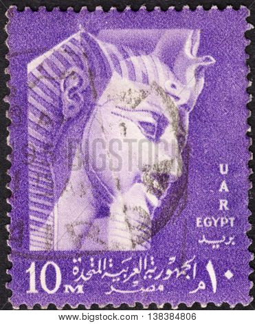 MOSCOW RUSSIA - JANUARY 2016: a post stamp printed in United Arab Republic (UAR) shows a mask of the Pharaoh Ramses II the series