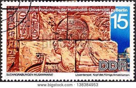 MOSCOW RUSSIA - CIRCA JANUARY 2016: a post stamp printed in DDR shows a head of the King Arnekhamani carvings unearthed at Lions Temple the series