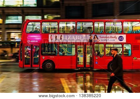 Red Double Decker Bus In Motion Blur In London Night Traffic