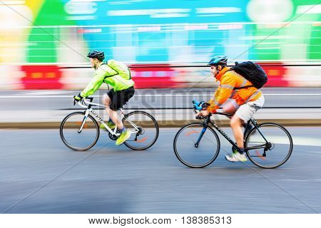 Cyclists In Motion Blur In The City Traffic Of London, Uk