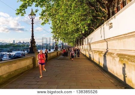 Strolling People On The Thames Promenade