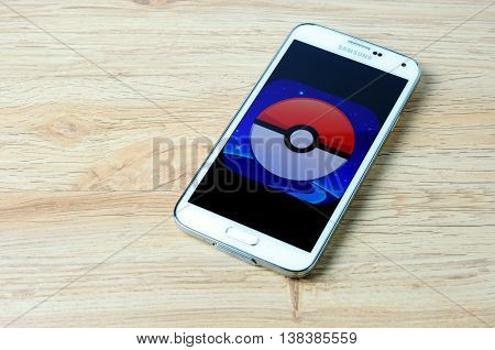 KOTA KINABALU MALAYSIA - 14 JULY 2016: Pokemon Go logo on a smart phone screen a free-to-play augmented reality mobile game developed by Niantic for iOS and Android devices.
