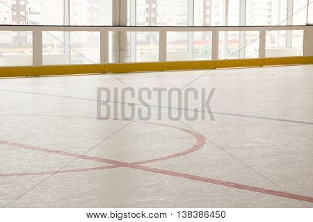 red line on hockey rink. Face off circle. modern empty rink. Front view from ice