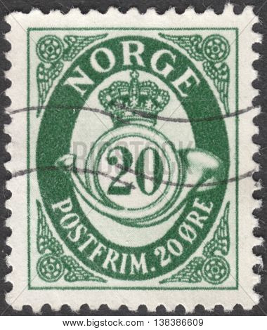MOSCOW RUSSIA - JANUARY 2016: a post stamp printed in NORWAY shows image of crown and post horn the series