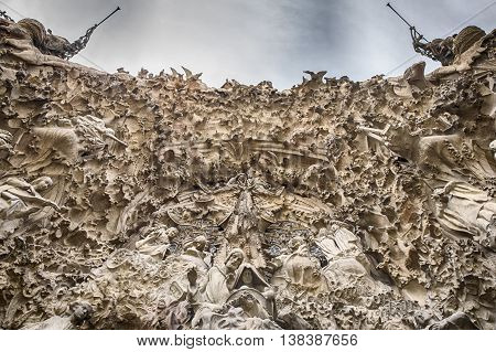 BARCELONA, SPAIN - APRIL 18, 2015: A view of the Nativity Facade on the Sagrada Familia in Barcelona as viewed from directly below the main entrance.