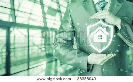 House protection and insurance. Home shield. Real estate safety. Terminal background. Airport and railroad station concept.