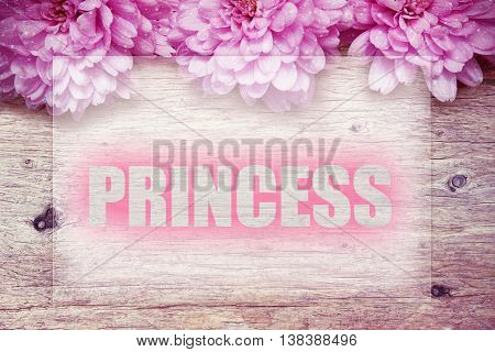 pink flowers on wooden with word PRINCESS