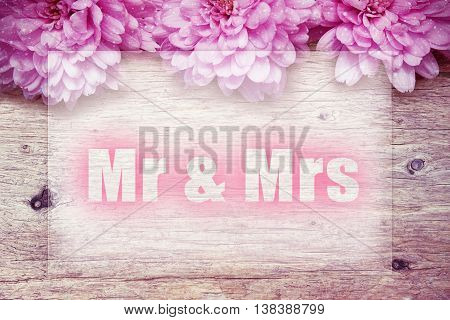pink flowers on wooden with word Mr. & Mrs.