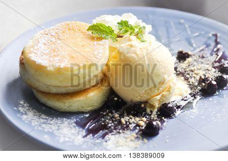 pancake and vanilla ice cream with blueberry sauce dish