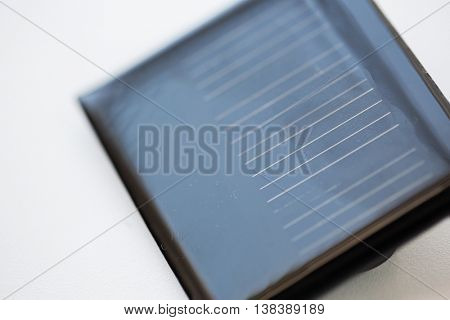 recycling, energy, power, environment and ecology concept - close up of solar battery or cell